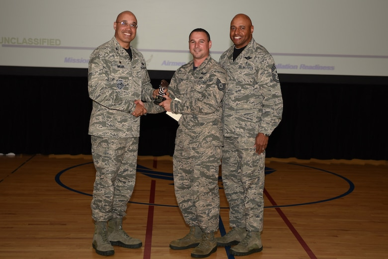 Paul Sleeper, 460th Operations Group, receives the Noncommissioned Officer of the Quarter Award May 19, 2017, on Buckley Air Force Base, Colo.  Awards were given to the Team Buckley members who showed dedication, hard work and exceeded their supervisor's expectations. (U.S. Air Force photo by Airman 1st Class Holden S. Faul/ released)