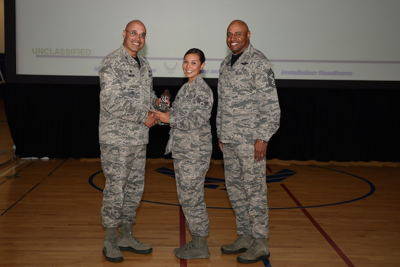 Senior Airman Amanda Kravchuk, 460th Space Wing general law paralegal, receives the Quarter Award May 19, 2017, on Buckley Air Force Base, Colo.  Awards were given to the Team Buckley members who showed dedication, hard work and exceeded their supervisor's expectations. (U.S. Air Force photo by Airman 1st Class Holden S. Faul/ released)