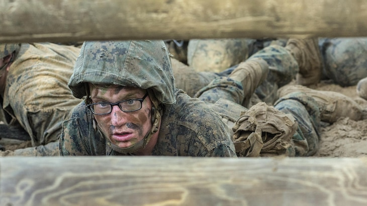 Marine Corps recruit Robbin Anderson low-crawls while going through the combat endurance course at Parris Island, S.C., May 20, 2017. The course includes a 2.5-mile run with obstacles. Marine Corps photo by Cpl. Richard Currier