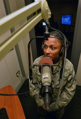 U.S. Air Force Tech. Sgt. Jamila Jahic, American Forces Network Weather Center NCO in charge, records the day's global-forecasts in a sound booth at the 557th Weather Wing headquarters March 31, Offutt Air Force Base, Neb.  Jahic leads five Airmen that are tasked with providing 1,000 pieces of weather data to 400,000 members of the Department of Defense and Department of State stationed around the globe. (U.S. Air Force photo by Josh Plueger)