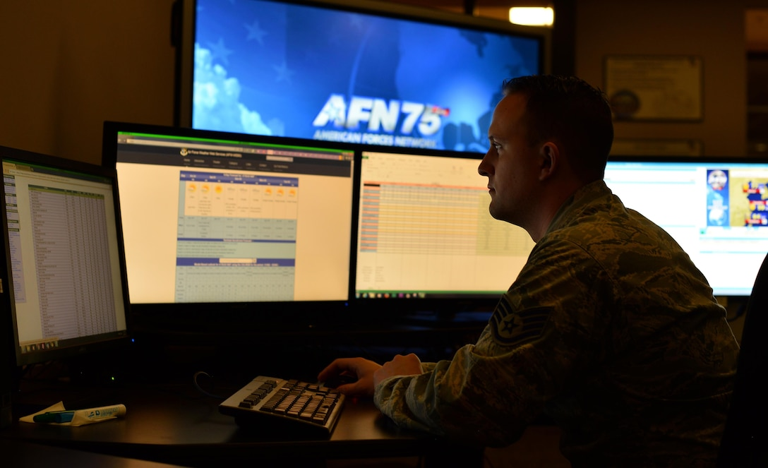 U.S. Air Force Staff Sgt. Owen Thompson, American Forces Network Weather Center forecaster, compiles regional weather data at the 557th Weather Wing headquarters March 31, Offutt Air Force Base, Neb.  Airmen assigned to the AFN Weather Center record weather broadcasts for globally dispersed members of the Department of Defense, Department of State and their dependents.  (U.S. Air Force photo by Josh Plueger)