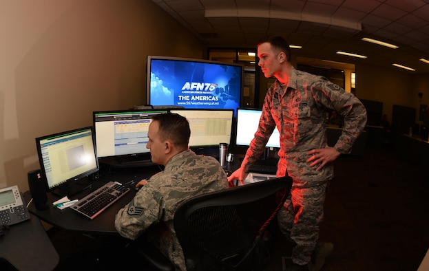 U.S. Air Force Staff Sgt. Owen Thompson and Ryan Whitson, American Forces Network Weather Center forecasters, review weather data they will use in their daily, global forecasts in the 557th Weather Wing headquarters on March 31, Offutt Air Force Base, Neb.  The forecasts are featured in several mediums to include eight AFN television channels that now broadcast their shows in High Definition.  (U.S. Air Force photo by Josh Plueger)
