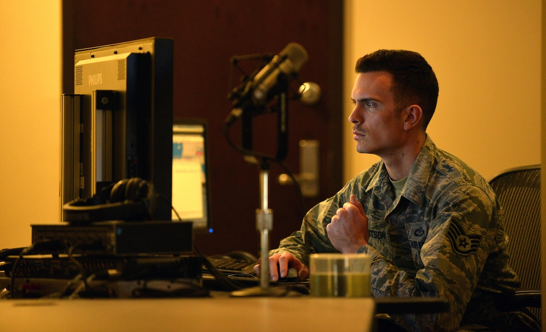 U.S Air Force Staff Sgt. Ryan Whitson, American Forces Network Weather Center forecaster, reviews weather data at the 557th Weather Wing headquarters March 31, Offutt Air Force Base, Neb.  The five Airmen team assigned the AFN Weather Center are the sole forecasters in charge of recording daily weather broadcasts for the internet, prints and television shows worldwide. (U.S. Air Force photo by Josh Plueger)