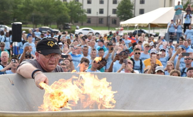 Craig Foshee, Area 1 athlete, lights the torch to open the games during the Special Olympics Mississippi 2017 Summer Games opening ceremonies at the Levitow Training Support Facility drill pad May 19, 2017, on Keesler Air Force Base, Miss. Founded in 1968, Special Olympics hosts sporting events around the world for people of all ages with special needs to include more than 700 athletes from Mississippi. (U.S. Air Force photo by Kemberly Groue)