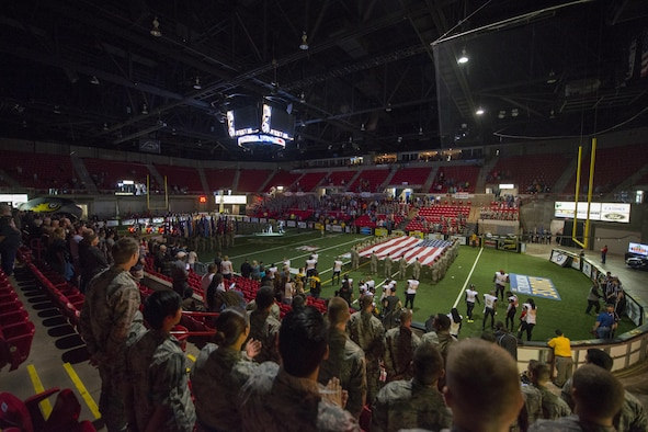 Airmen from Sheppard Air Force Base, Texas, participate as spectators, flag bearers, and demonstration squadrons for the Nighthawks military appreciation football game at the Kay Yeager Coliseum in downtown Wichita Falls, Texas, May 20, 2017. The game was close, but the Nighthawks lost with a final score of 47 to 50 against the Iowa Barnstormers. (U.S. Air Force photo by 2nd Lt. Jacqueline Jastrzebski)