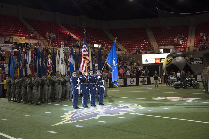 Airmen from Sheppard Air Force Base, Texas, participate as spectators, flag bearers, and demonstration squadrons for the Nighthawks military appreciation football game at the Kay Yeager Coliseum in downtown Wichita Falls, Texas, May 20, 2017. The game opened with a squadron of flag bearers in formation, an honor guard team presenting the colors, a large group of Airmen holding the U.S. flag, and another group of Airmen lined up as the fan tunnel. (U.S. Air Force photo by Staff Sgt. Kyle E. Gese)