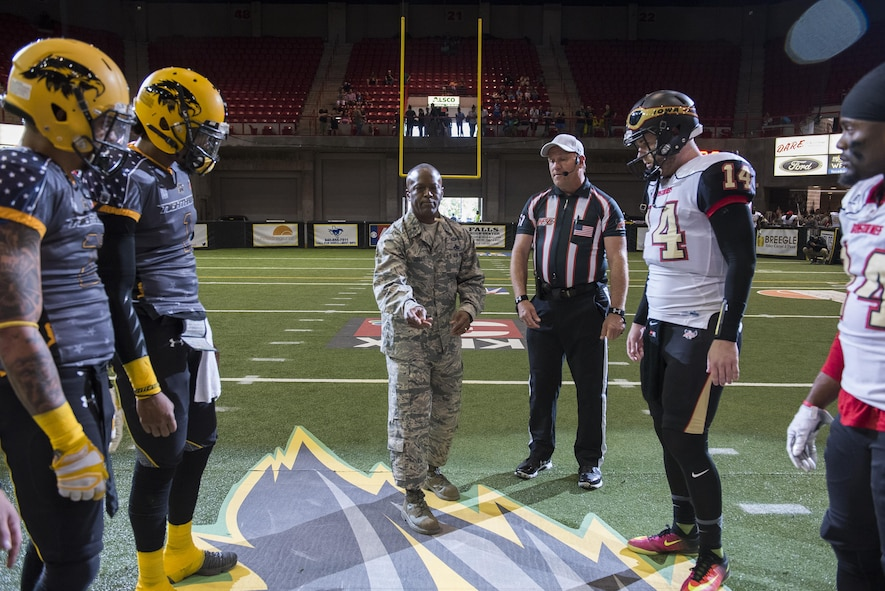 Brig. Gen. Ronald Jolly Sr., 82nd Training Wing commander, tosses the game coin for the Nighthawks military appreciation game who played against the Iowa Barnstormers at the Kay Yeager Coliseum in downtown Wichita Falls, Texas, May 20, 2017. The Nighthawks won the coin toss and started the game. (U.S. Air Force photo by Staff Sgt. Kyle E. Gese)