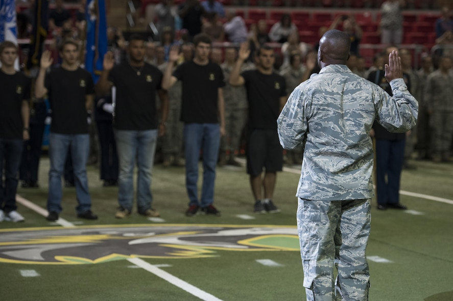 Brig. Gen. Ronald Jolly Sr., 82nd Training Wing commander, administers the oath of enlistment to future Airmen, Soldiers and Sailors during the Nighthawks military appreciation football game at the Kay Yeager Coliseum in downtown Wichita Falls, Texas, May 20, 2017. There were three U.S. Navy, six U.S. Army and three U.S. Air Force enlistees who took the oath during half-time. (U.S. Air Force photo by Staff Sgt. Kyle E. Gese)