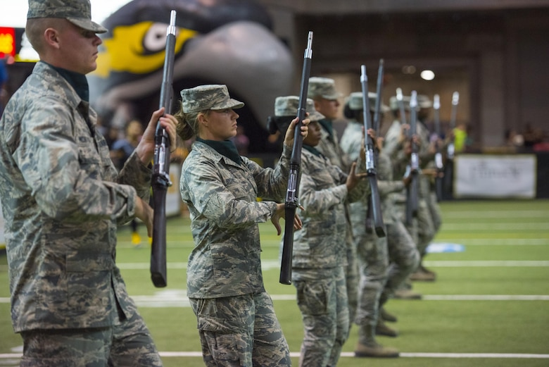 Airmen from the 363rd Training Squadron at Sheppard Air Force Base, Texas, perform a military drill demonstration during the Nighthawks military appreciation football game at the Kay Yeager Coliseum in downtown Wichita Falls, Texas, May 20, 2017. Military drill is a historic tradition which was used to strategically move troops from one place to another while acting as a show of force. It is carried out today to honor heritage, and display the training and discipline of the U.S. Armed Forces. (U.S. Air Force photo by Staff Sgt. Kyle E. Gese)