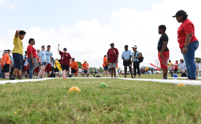 Athletes compete in the bocce event during the Special Olympics Mississippi 2017 Summer Games May 20, 2017, on Keesler Air Force Base, Miss. Founded in 1968, Special Olympics hosts sporting events around the world for people of all ages with special needs to include more than 700 athletes from Mississippi. (U.S. Air Force photo by Kemberly Groue)