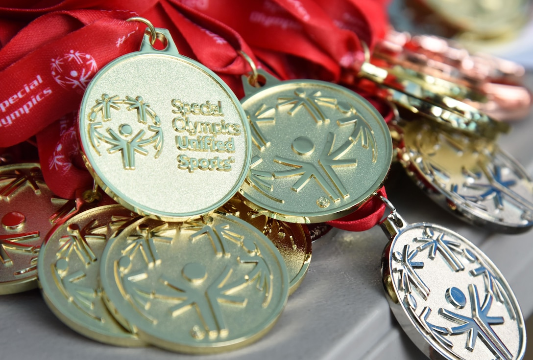 Medals sit on display during the Special Olympics Mississippi 2017 Summer Games May 20, 2017, on Keesler Air Force Base, Miss. Keesler hosted more than 3,200 athletes, directors, coaches, family members and volunteers spanning over 16 regions across Mississippi for the 31st year. (U.S. Air Force photo by Kemberly Groue)