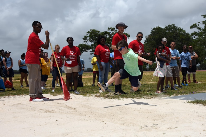 Mikey Balfour, Area 8 athlete, leaps into the air in the running long jump event during the Special Olympics Mississippi 2017 Summer Games May 20, 2017, on Keesler Air Force Base, Miss. Founded in 1968, Special Olympics hosts sporting events around the world for people of all ages with special needs to include more than 700 athletes from Mississippi. (U.S. Air Force photo by Kemberly Groue)