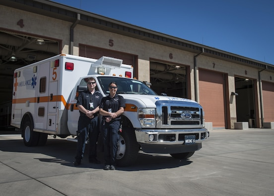 Arin Meyer, a 49th Medical Operations Squadron emergency medical technician-Basic, and Jillian Barker, a 49th MDOS paramedic, pose for a photo outside the fire station for National Emergency Medical Services week at Holloman Air Force Base, N.M. on May 17, 2017. National EMS week was established in 1974, as a means to honor EMS practitioners and their contributions to families and communities across the United States. Licensing to become an emergency medical technician requires formal training at the EMT-Basic, EMT-Intermediate or EMT-Paramedic level. Training programs are offered at emergency medical service academies and other educational institutions. (U.S. Air Force photo by Airman 1st Class Alexis P. Docherty)