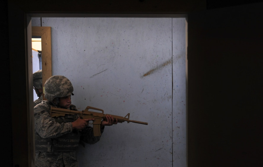 Airman 1st Class Benedetto Mancini, 99th Security Forces Squadron member, covers the rear of a rescue team in a hallway during a training scenario in Area II on Nellis Air Force Base, Nev., May 17, 2017. The exercise was designed to prepare and test the response efforts of SFS Airmen in the event of a dangerous situation. (U.S. Air Force photo by Senior Airman Kevin Tanenbaum/Released)