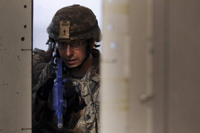 Staff Sgt. Kenneth Delongchamp, 99th Security Forces Squadron member, prepares to enter a doorway during a training scenario in Area II on Nellis Air Force Base, Nev., May 17, 2017. The 99th SFS designs realistic exercises to keep Airmen in a warrior mindset and sharpen tactics, techniques and procedures to prevent unnecessary loss of life and injuries in the event of a real-world incident. (U.S. Air Force photo by Senior Airman Kevin Tanenbaum/Released)