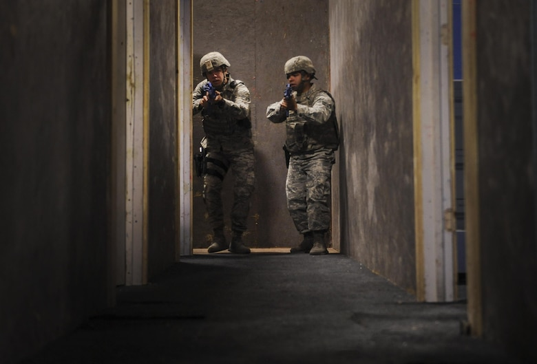 Senior Airman Jesus Guerrero and Airman 1st Class Emilio Rodriguez, 99th Security Forces Squadron members, clear rooms during an active-shooter training scenario in Area II on Nellis Air Force Base, Nev., May 17, 2017. All law enforcement and security response team patrols need to be capable to respond to a variety of emergencies. (U.S. Air Force photo by Senior Airman Kevin Tanenbaum/Released)