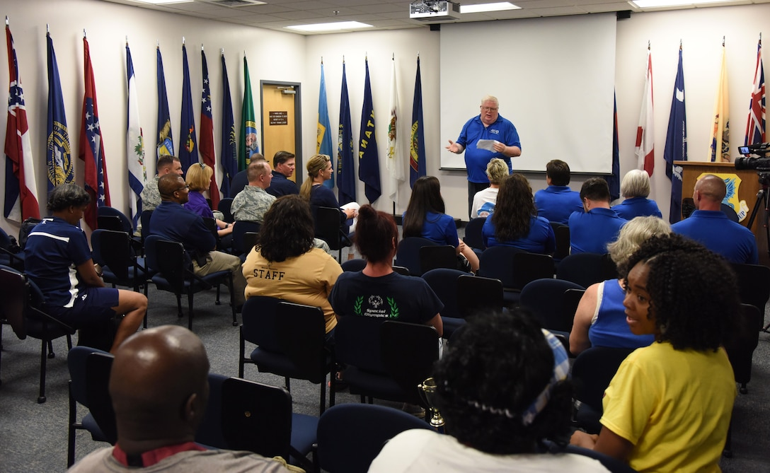 Randy Simmons, 338th Training Squadron instructor supervisor, delivers remarks during the Special Olympics Mississippi 2017 Summer Games closing ceremony at the Levitow Training Support Facility May 20, 2017, on Keesler Air Force Base, Miss. Founded in 1968, Special Olympics hosts sporting events around the world for people of all ages with special needs to include more than 700 athletes from Mississippi. (U.S. Air Force photo by Kemberly Groue)