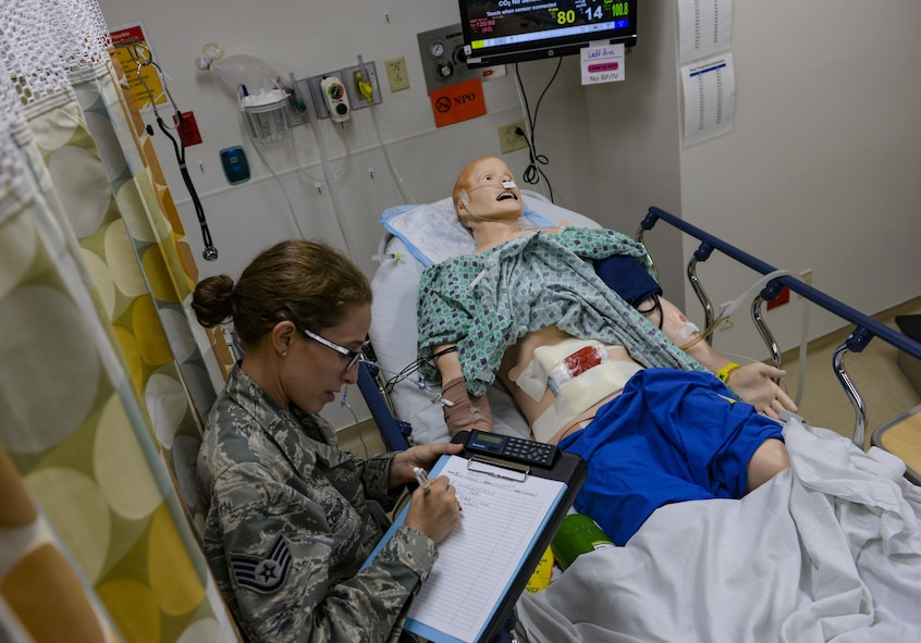 Staff Sgt. Jacquelyn Longar, 99th Medical Group aerospace medical technician, participates in the patient safety room of horrors event in the Mike O'Callaghan Medical Center at Nellis Air Force Base, Nev., May 10, 2017. The participants of the event had to identify as many safety violations as they could in five minutes. (U.S. Air Force photo by Airman 1st Class Nathan Byrnes/Released)