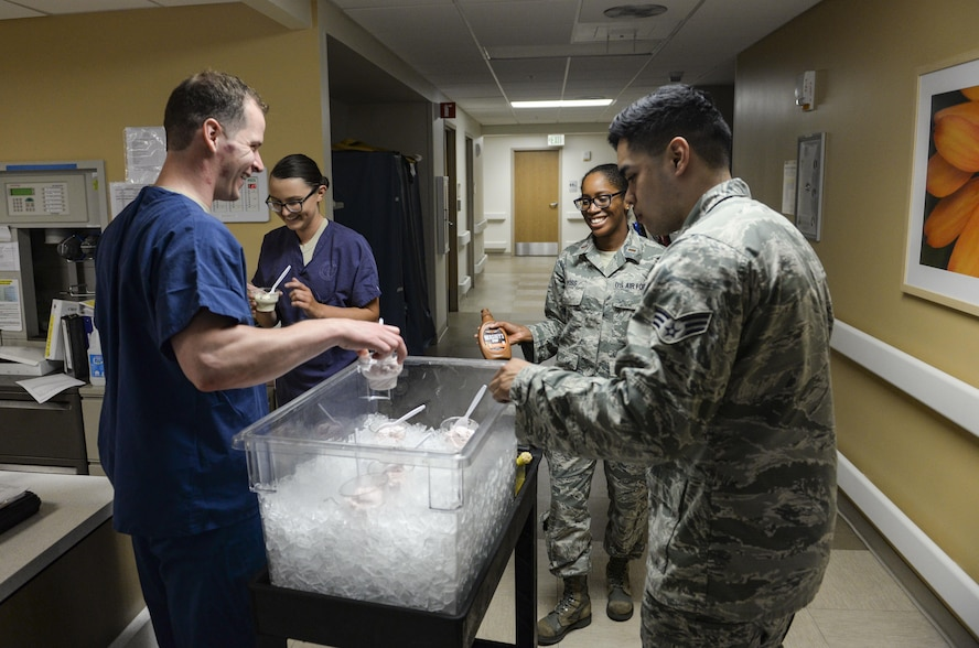 Nurses and medical technicians from the 99th Medical Group Intensive Care Unit brought ice cream as a part of Nurse and Medical Technician Week at Nellis Air Force Base, Nev., May 11, 2017. Nursing and medical technicians are physically demanding positions and often require working long hours, nights and weekends. (U.S. Air Force photo by Airman 1st Class Nathan Byrnes/Released)