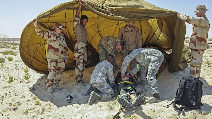 U.S. airmen and French security forces prepare a simulated casualty for transport during a joint crash exercise at an undisclosed location in Southwest Asia, May 16, 2017. Air Force photo by Staff Sgt. Marjorie A. Bowlden