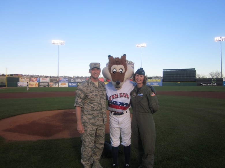 Col. Robyn Slade (right), 50th Space Wing senior individual mobilization augmentee to the commander, stands with Col. David Harris, United States Air Force Academy vice superintendent, and Sky Sox Mascot during the Sky Sox Air Force Night at Security Service Field, Colorado Springs, Colorado, Friday, May 12, 2017. The Sky Sox Air Force Night was one of the last events Slade would attend as IMA to the commander. (Courtesy photo)