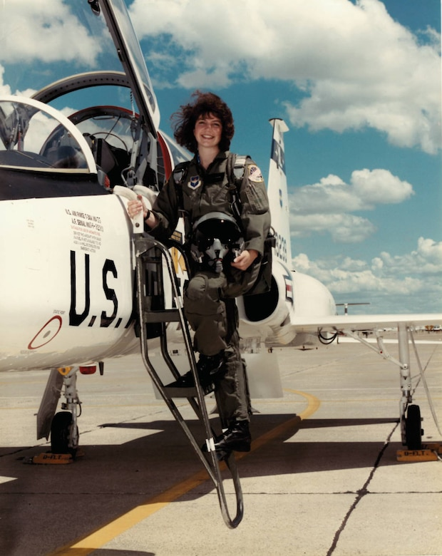 Col. Robyn Slade, 50th Space Wing senior individual mobilization augmentee to the commander, stands proudly with the t-38 she flew she flew at initial pilot training. Slade began her Air Force career within Public Affairs, but was able to pursue her dream of flying after years of hard work. (Courtesy photo)