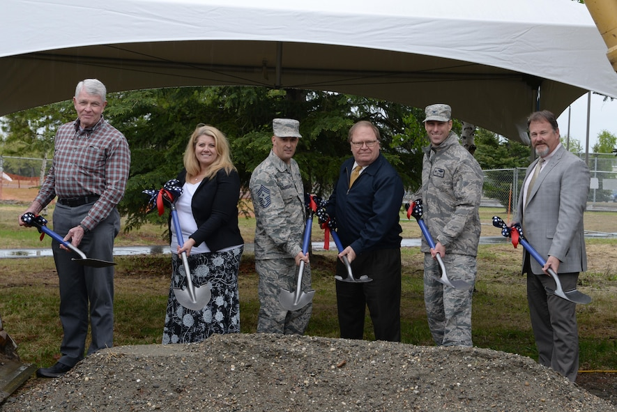 U.S. Air Force Col. David Mineau, the 354th Fighter Wing (FW) commander, and Chief Master Sgt. Brent Sheehan, the 354th FW command chief, break ground for the new community center with several representatives from various agencies, May 22, 2017, at Eielson Air Force Base, Alaska. The plans for the building are to start small and leave room for future additions once an evaluation of the base is done when the 3,500 expected personnel arrive for the F-35A Lightning II. (U.S. Air Force photo by Senior Airman Kahdija Slaughter)