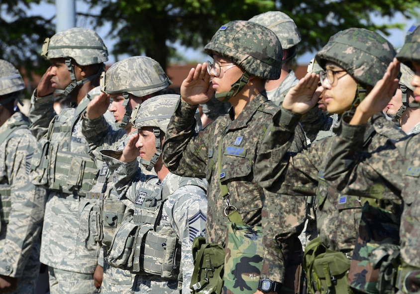 U.S. Air Force 51st Security Forces Squadron and Republic of Korea Military Police members render a salute during a Memorial Retreat Ceremony, at Osan Air Base, Republic of Korea, May 19, 2017. The solemn ceremony was the height of Police Week, a week dedicated to honoring those who gave the ultimate sacrifice in the line of duty. (U.S. Air Force photo by Staff Sgt. Alex Fox Echols III)