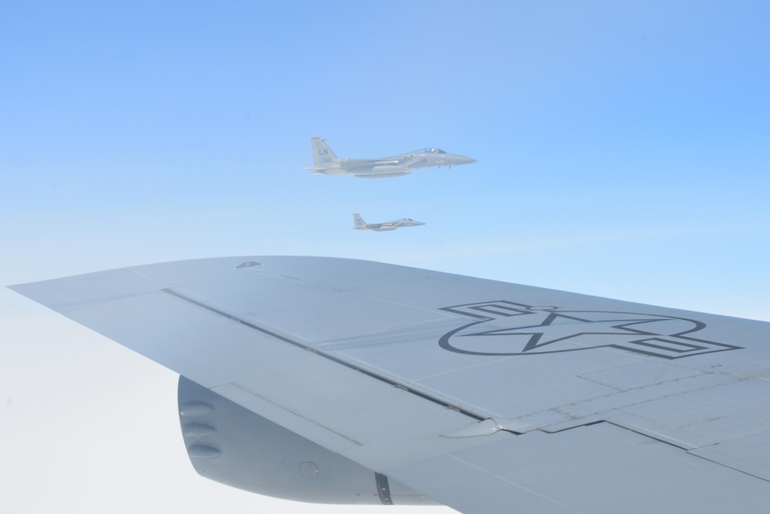 Two F-15 Eagle aircraft from RAF Lakenheath, England, fly in formation next to the KC-135 Stratotanker they just refueled from May 19, 2017. The KC-135 is assigned to RAF Mildenhall, England. All three aircraft are on their way to support Arctic Challenge 2017, a multinational exercise encompassing 11 nations and more than 100 aircraft. (U.S. Air Force photo by Tech. Sgt. David Dobrydney)