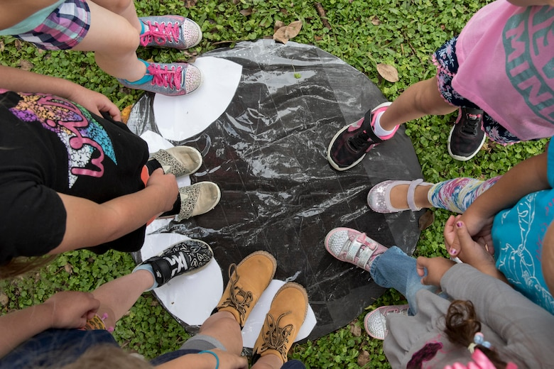 Children from Kadena Elementary School compare their feet to that of the world's largest land-walking animal, an African elephant, May 22, 2017, during a school-wide educational event at Kadena Air Base, Japan. The Guinness Book of World Records sent 38 hard back books to the students to support the event and to broaden their experience. (U.S. Air Force photo by Senior Airman John Linzmeier)