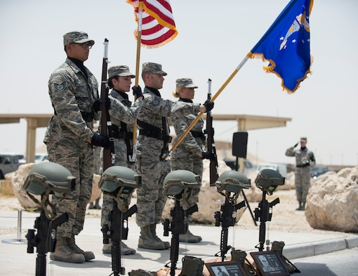 U.S. Air Force airmen with the Al Udeid Air Base honor guard presents the Colors for the final guardmount ceremony at Al Udeid Air Base, Qatar, May 19, 2017. The final guardmount ceremony is a tradition where all members of 379th Expeditionary Security Forces Squadron pay tribute to fallen Security Forces Airmen and U.S. Air Force Office of Special Investigations agents who have died in the line of duty by calling out their names as the flight sergeant conducts roll call. (U.S. Air Force photo by Tech. Sgt. Amy M. Lovgren)