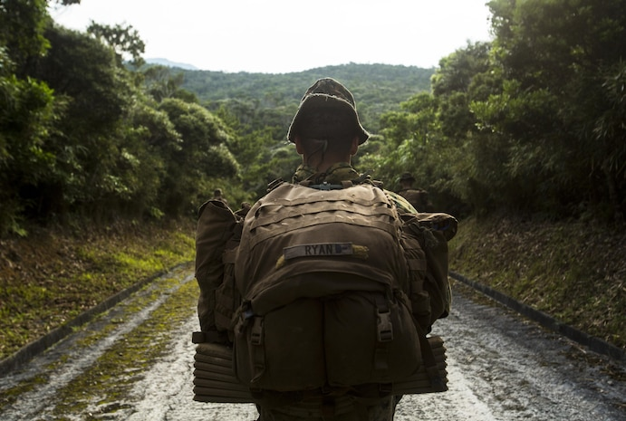 Cpl. Patrick Ryan conducts a patrol at Jungle Warfare Training Center, Camp Gonzalves, Okinawa, Japan, May 17, 2017. The unit patrolled through the woods, conducted medical evacuations and assaulted enemy villages during their 12-day training iteration. This training prepares them for their upcoming deployment to Thailand and the Philippines in support of the Cooperation Afloat Readiness and Training multilateral exercise. Ryan, a native of Falmouth, Massachusetts, is a squad leader for Company K, 3rd Battalion, 8th Marine Regiment and is assigned to 3rd Marine Division, III Marine Expeditionary Force, through the unit deployment program. (U.S. Marine Corps photo by Lance Cpl. Joshua Pinkney)