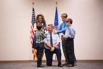 Col. Brian May, 403rd Operations Group commander, has colonel rank pinned on by his wife Kathy and their sons Giovanni, Darrio and Cameron during his promotion ceremony March 4, 2017 at Keesler Air Force Base, Mississippi. (U.S. Air Force photo/Staff Sgt. Heather Heiney)