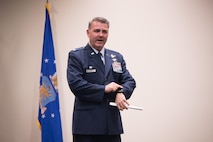 Col. Brian May, 403rd Operations Group commander speaks about the importance of trusting his people during his promotion ceremony March 4, 2017 at Keesler Air Force Base, Mississippi. (U.S. Air Force photo/Staff Sgt. Heather Heiney)