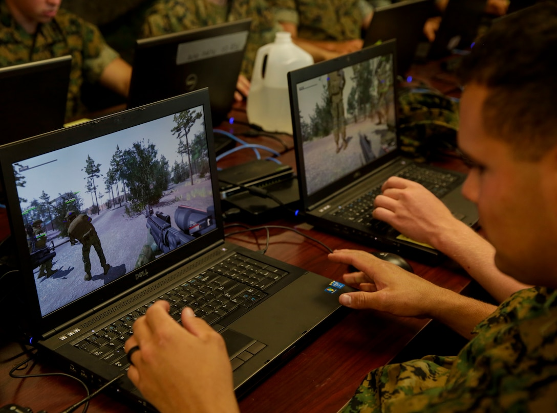 A Marine familiarizes himself with the controls of a virtual training program during a Spartan Tactical Games competition at Camp Lejeune, N.C., May 16, 2017. The Marines participated in a squad versus squad virtual training exercise to improve their tactics and maneuvers in a controlled environment. The Marines are with 2nd Battalion, 6th Marine Regiment. (U.S. Marine Photo by Lance Cpl Leynard Kyle Plazo)