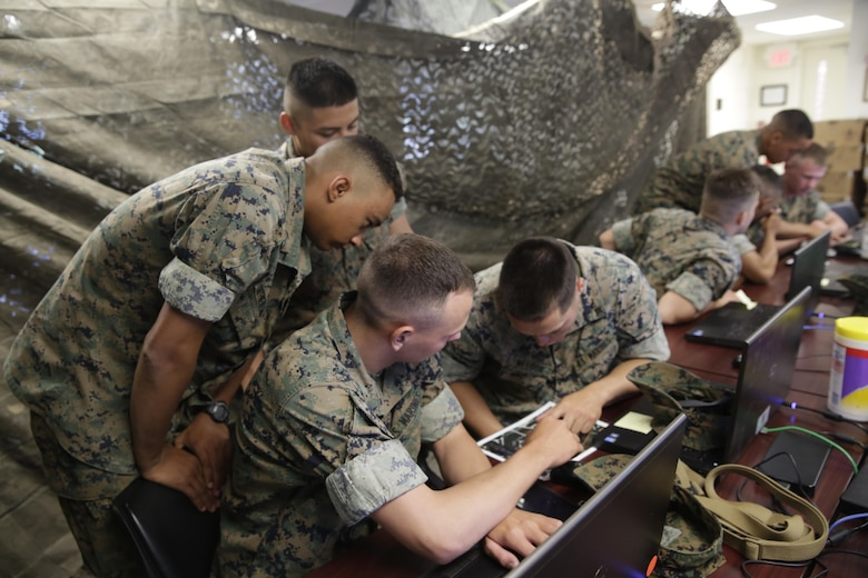 Marines discuss during a Spartan Tactical Games competition at Camp Lejeune, N.C., May 17, 2017. The Marines participated in a squad versus squad virtual training exercise to improve their tactics and maneuvers in a controlled environment. The Marines are with 2nd Battalion, 6th Marines Regiment. (U.S. Marine Photo by Lance Cpl Leynard Kyle Plazo)