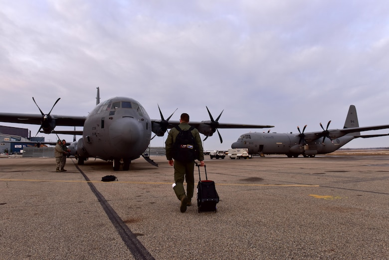 U.S. Air Force Capt. David Tart, 41st Airlift Squadron pilot, steps to his C-130J in preparation for the first Fanatic Pegasus exercise mission with Royal Canadian air forces in Edmonton, Canada, April 20, 2017. This is the first time American forces have participated in this exercise which establishes air and ground forces in unfamiliar terrain to work on communication and rapid deployment of those resources. (U.S. Air Force photo by Staff Sgt. Jeremy McGuffin)