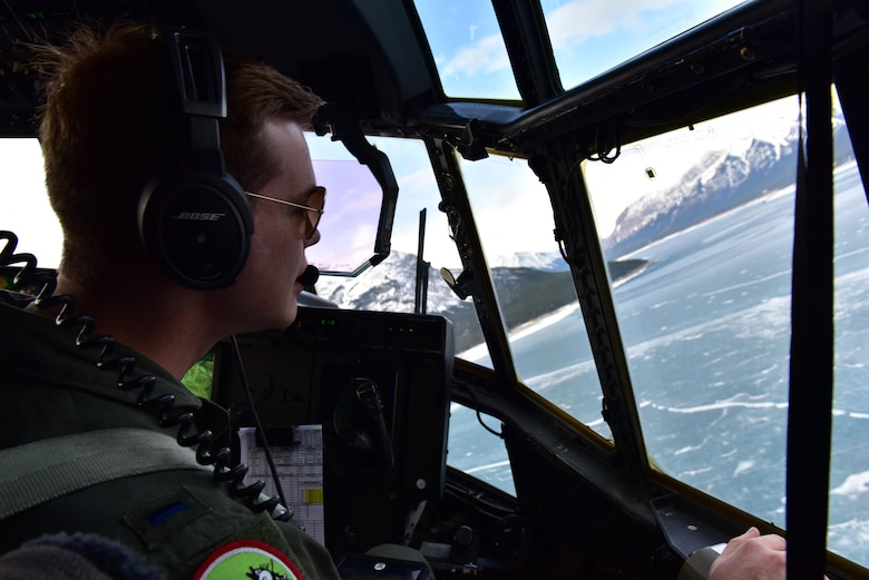 U.S. Air Force 1st Lt. Alex Randall, 41st Airlift Squadron pilot, looks out over a frozen lake in the Canadian Rockies during the first Fanatic Pegasus exercise mission with Royal Canadian air forces in Alberta, Canada, April 20, 2017. This is the first time American forces have participated in this exercise which establishes air and ground forces in unfamiliar terrain to work on communication and rapid deployment of those resources. (U.S. Air Force photo by Staff Sgt. Jeremy McGuffin)