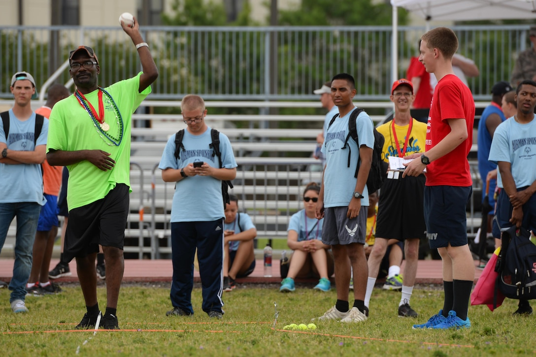A Special Olympics athlete winds up a throw at a softball throw competition during the SOMS 2017 Summer Games at the Triangle Track, May 20, 2017, on Keesler Air Force Base, Miss. Founded in 1968, Special Olympics hosts sporting events around the world for people of all ages with special needs, to include more than 700 athletes from Mississippi. (U.S. Air Force photo by Senior Airman Duncan McElroy)