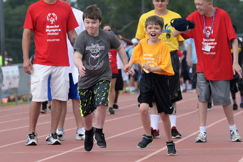 Korban Ossary, Area 11 athlete, and Malachy Harrison, Area 3 athlete, run the 50 meter dash during the Special Olympics Mississippi 2017 Summer Games at the Triangle Track May 20, 2017, on Keesler Air Force Base, Miss. Founded in 1968, Special Olympics hosts sporting events around the world for people of all ages with special needs to include more than 700 athletes from Mississippi. (U.S. Air Force photo by Airman 1st Class Travis Beihl)
