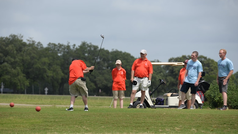 A Special Olympics athlete golfs during the Special Olympics Mississippi 2017 Summer Games at the Bay Breeze Golf Course May 20, 2017, on Keesler Air Force Base, Miss. Keesler hosted more than 3,200 athletes, directors, coaches, family members and volunteers spanning over 16 regions across Mississippi for the 31st year. (U.S. Air Force photo by Airman 1st Class Travis Beihl)