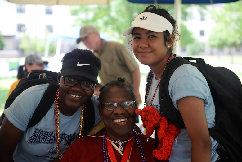 Renalda Lamour and Margarita Anguiano, 335th Training Squadron Airman sponsors, and Queen Greenlaw, Area 6 athlete, pose for a photo during the Special Olympics Mississippi 2017 Summer Games at Olympic Village May 20, 2017, on Keesler Air Force Base, Miss. Keesler hosted more than 3,200 athletes, directors, coaches, family members and volunteers spanning over 16 regions across Mississippi for the 31st year. (U.S. Air Force photo by Airman 1st Class Travis Beihl)