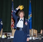 "Colonel Michelle Hayworth, 688th Cyberspace Wing commander, participates in the tradition of ""Skulling In"" during a Dining Out celebrating the 92nd Cyberspace Operations Squadron's 75th anniversary May 12, 2017, at Joint Base San Antonio-Lackland. The tradition derives from the 92nd COS motto, ""Once A Skull, Always A Skull""."
