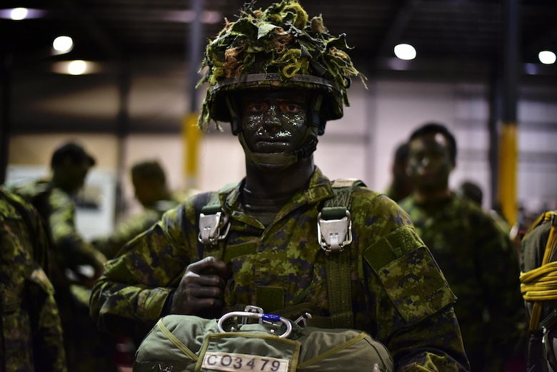 Canadian Army Private Joshua Lafountain, 3rd Princess Patricia Canadian Light Infantry, gets fitted into his parachute and gear before boarding a 41st Airlift Squadron C-130J April 22, 2017 in Alberta, Canada. The exercise Fanatic Pegasus focused on enhancing mobility partnerships between the U.S. and Canada in all aspects of Combat Airlift. (U.S. Air Force photo by Staff Sgt. Jeremy McGuffin)