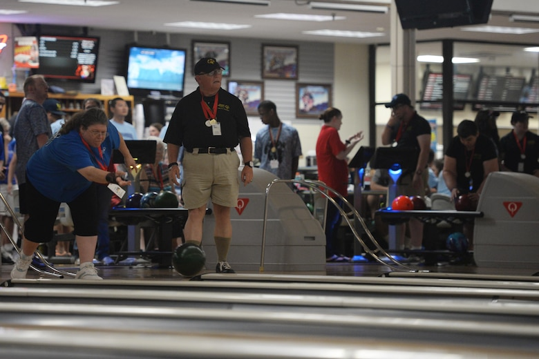 Tracey Shearer, Area 8 athlete, bowls during the Special Olympics Mississippi 2017 Summer Games at Gaude' Lanes May 20, 2017, on Keesler Air Force Base, Miss. Keesler hosted more than 3,200 athletes, directors, coaches, family members and volunteers spanning over 16 regions across Mississippi for the 31st year. (U.S. Air Force photo by Airman 1st Class Travis Beihl)