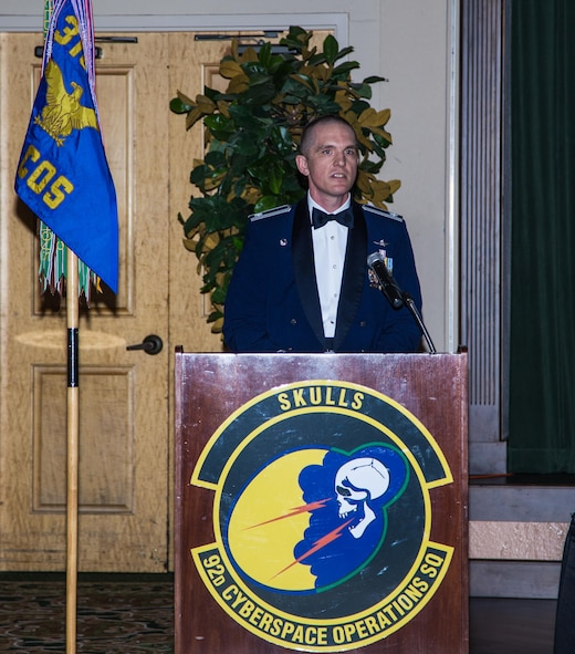 Lieutenant Col. Benjamin Montgomery, 92nd Cyberspace Operations Squadron commander, addresses the members of the mess during the 92nd COS 75th Anniversary Dining Out May 12, 2017, at Joint Base San Antonio-Lackland. Montgomery highlighted the squadron's many accomplishments dating back 75 years and how the squadron is carrying on traditions from combat in the air to combating adversaries in cyberspace.