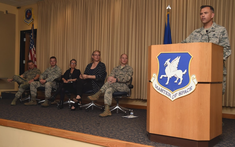 Col. Anthony Mastalir, 50th Space Wing vice wing commander, speaks to Airmen attending the Company Grade Officers' Council transgender panel at Schriever Air Force Base, Colorado, Wednesday, May 17, 2017. The discussion highlighted obstacles transgender service members face. (U.S. Air Force photo/Senior Airman Arielle Vasquez)