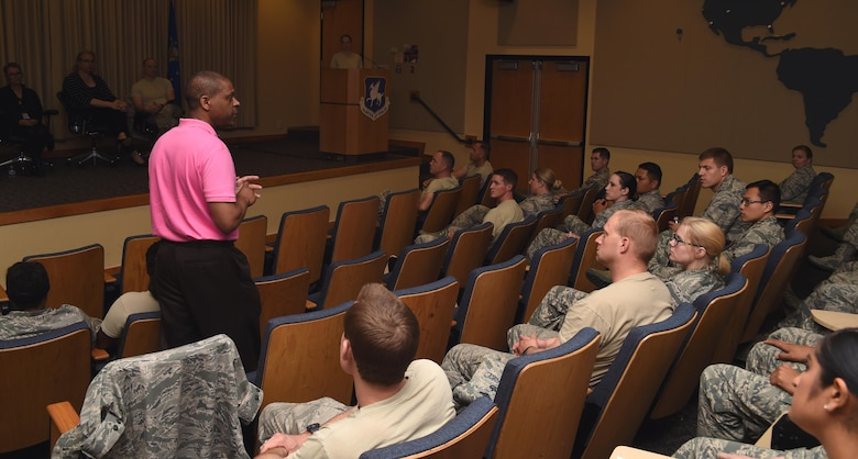Edward Vaughn, 50th Space Wing Equal Opportunity office, addresses Airmen at the Company Grade Officers' Council transgender panel at Schriever Air Force Base, Colorado, Wednesday, May 17, 2017. The discussion highlighted obstacles transgender service members face. Col. Anthony Mastalir, 50th Space Wing vice wing commander, encouraged attendees to remove outer garments to create a more relaxed environment.  (U.S. Air Force photo/Senior Airman Arielle Vasquez)