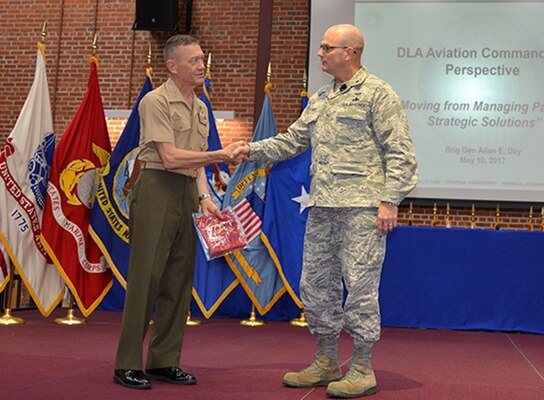 Defense Logistics Agency Aviation Commander Air Force Brig. Gen. Allan Day thanks Aviation's Marine Corps Deputy Commandant for Aviation Lt. Gen. Jon Davis as guest speaker during the Senior Executive Partnership Roundtable held May 10, 2017 at the Frank B. Lotts Conference Center on Defense Supply Center Richmond, Virginia. Davis spoke from a customers' perspective to senior executives from strategic supplier alliances, DLA Aviation leadership, and military customer senior leaders.