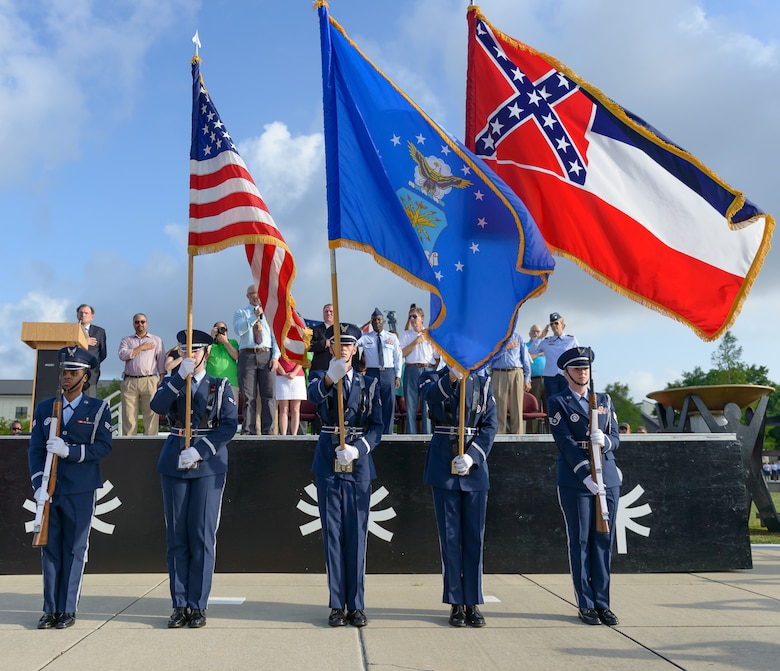Keesler Honor Guard members present the colors during the Special Olympics Mississippi 2017 Summer Games opening ceremonies at the Levitow Training Support Facility drill pad May 20, 2017, on Keesler Air Force Base, Miss. Founded in 1968, Special Olympics hosts sporting events around the world for people of all ages with special needs to include more than 700 athletes from Mississippi. (U.S. Air Force photo by Andre' Askew)